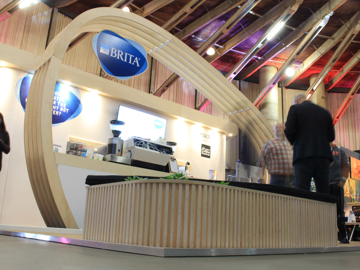 Liqui Exhibition Stand design - Brita-Trade-Stand - showing curving overhead construction in the shape of the Brita logo.