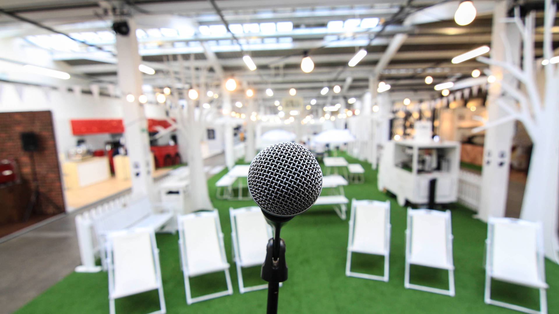 Liqui Event Design - London Coffee Festival - Hyde Park social area - showing close-up of microphone looking out to seating area.
