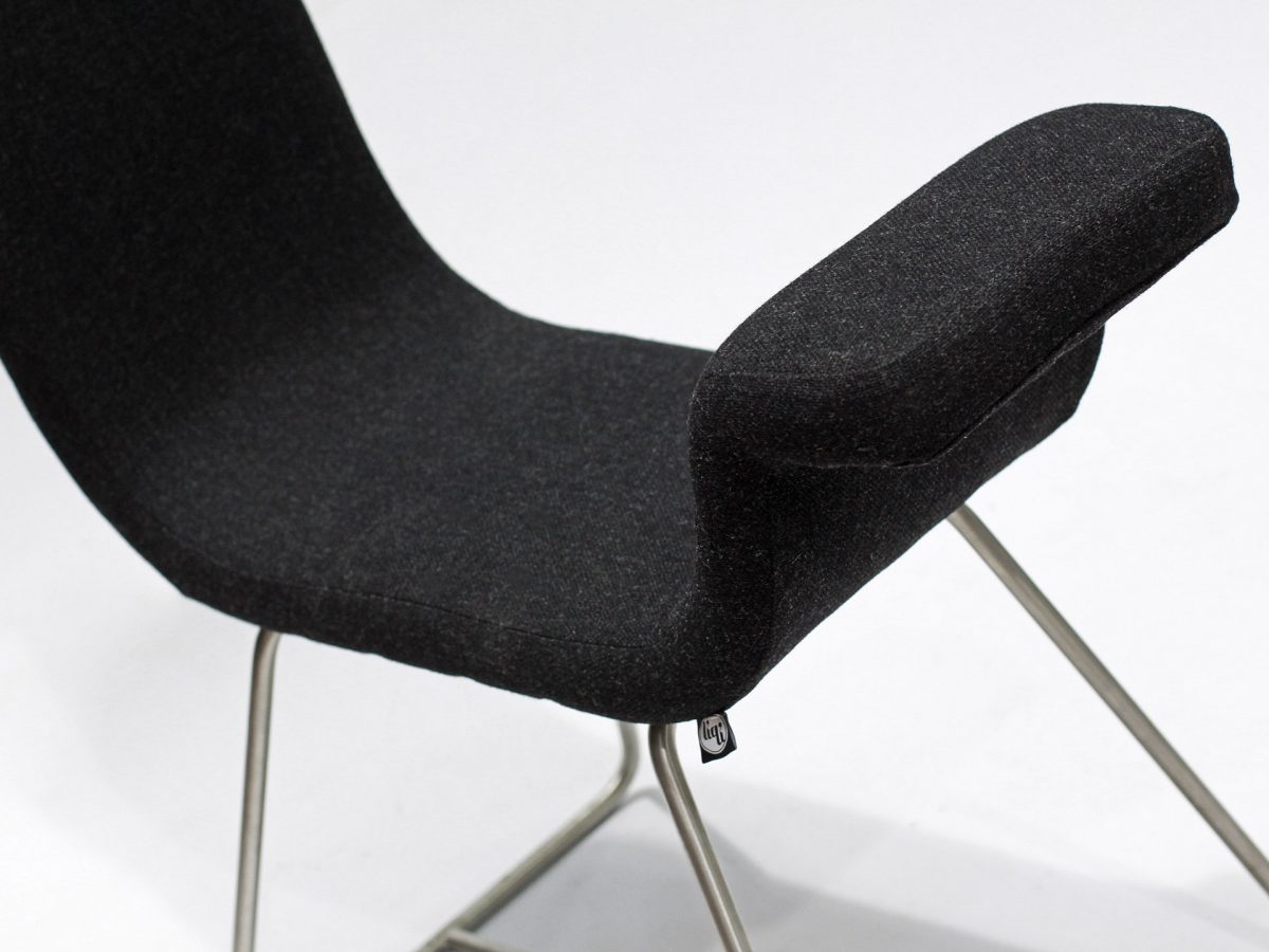 Liqui Contract Chair - A-normal - Close-up view - Sustainably sourced Birch Ply with recycled foam upholstered in Main Line Flax with stainless steel legs.