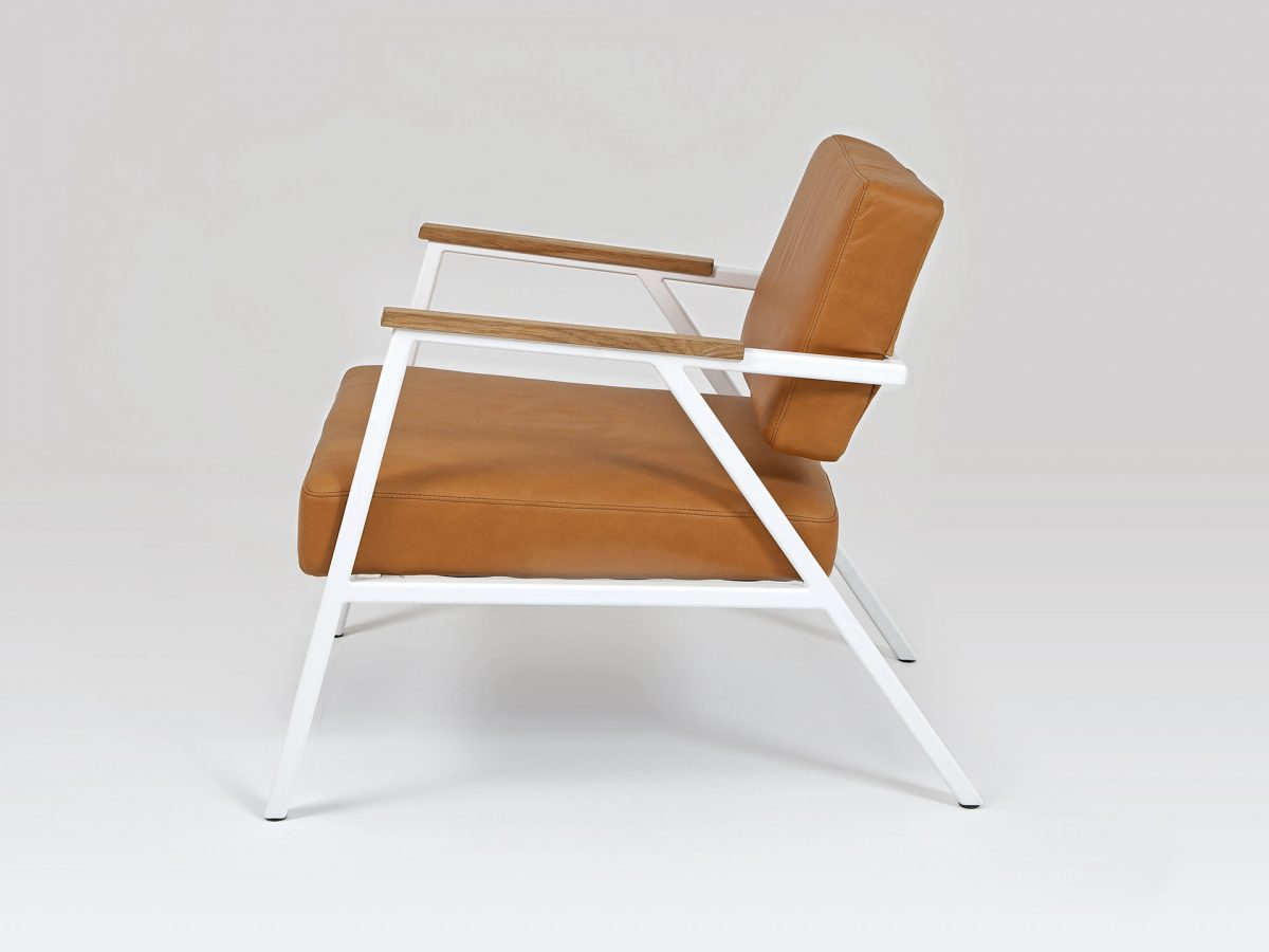 Liqui Studio Contract Easy Chair - Side view showing steel frame powder coated in white with leather upholstered seat and back rest.