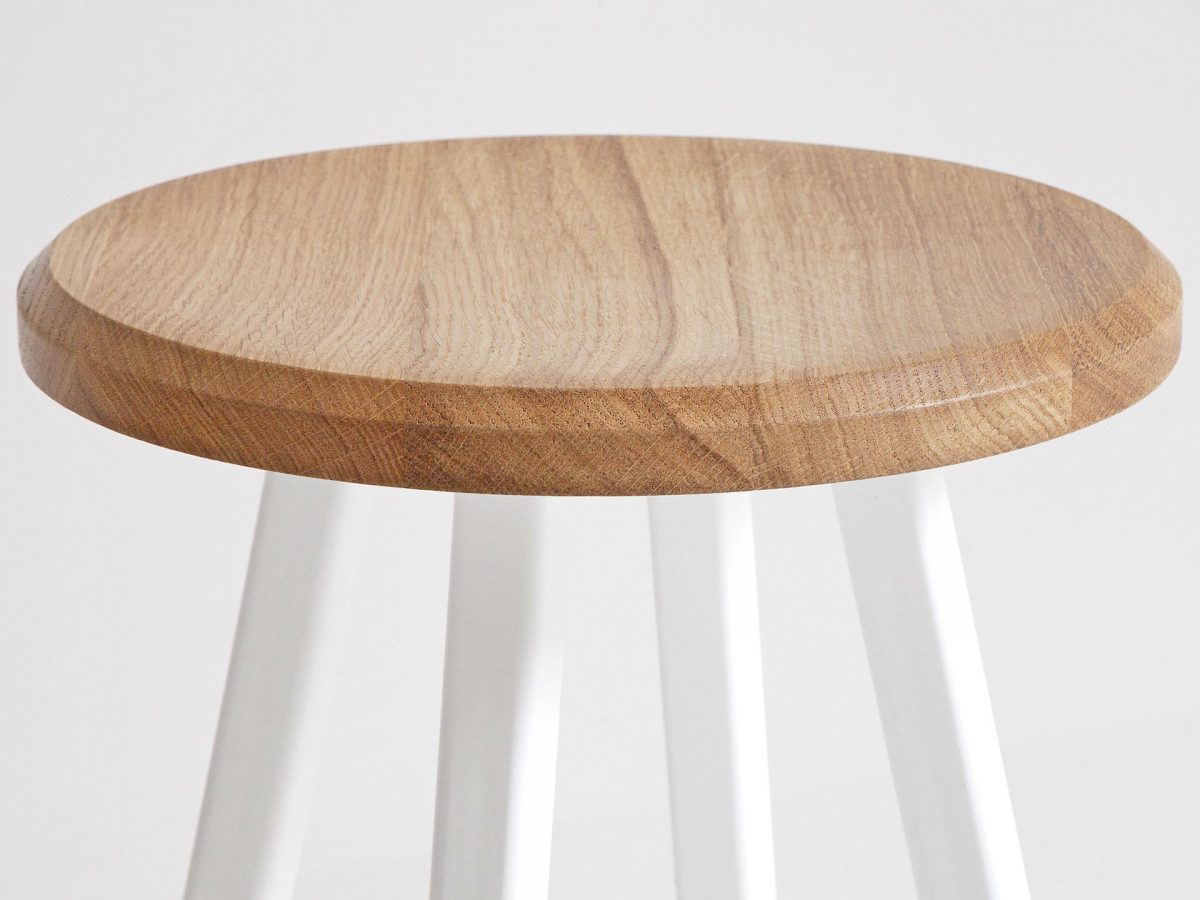 Liqui Commercial Studio Bar Stool - View of stool top showing powder coated stainless steel legs in white with concave shaped seat in sustainably sourced oak.