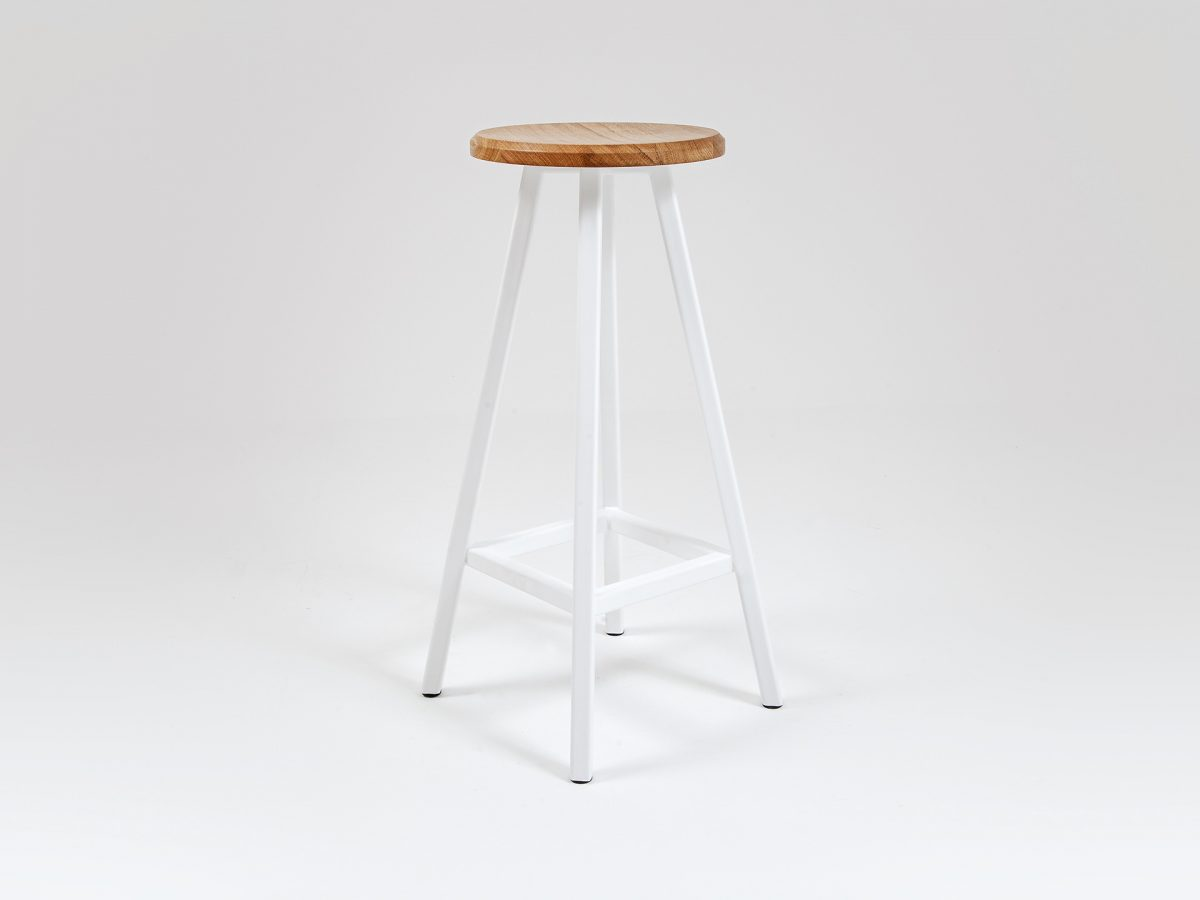 Liqui Commercial Studio Bar Stool - Front view showing powder coated stainless steel legs with concave shaped seat in sustainably sourced oak.
