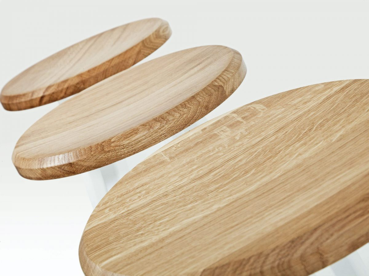 Liqui Commercial Studio Bar Stool - View of three stool tops showing powder coated stainless steel legs in white with concave shaped seats in sustainably sourced oak.