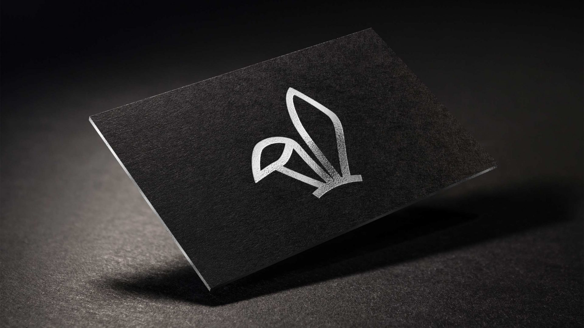 Crate47 Branding forThe Bunny bubble Tea shop – black business card with silver bunny ears marque
