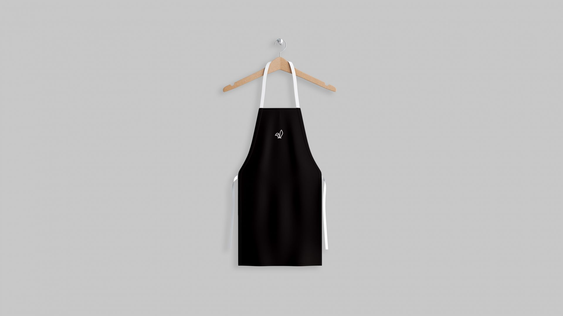 Crate47 Branding forThe Bunny boba tea store – white bunny ears marque on black apron