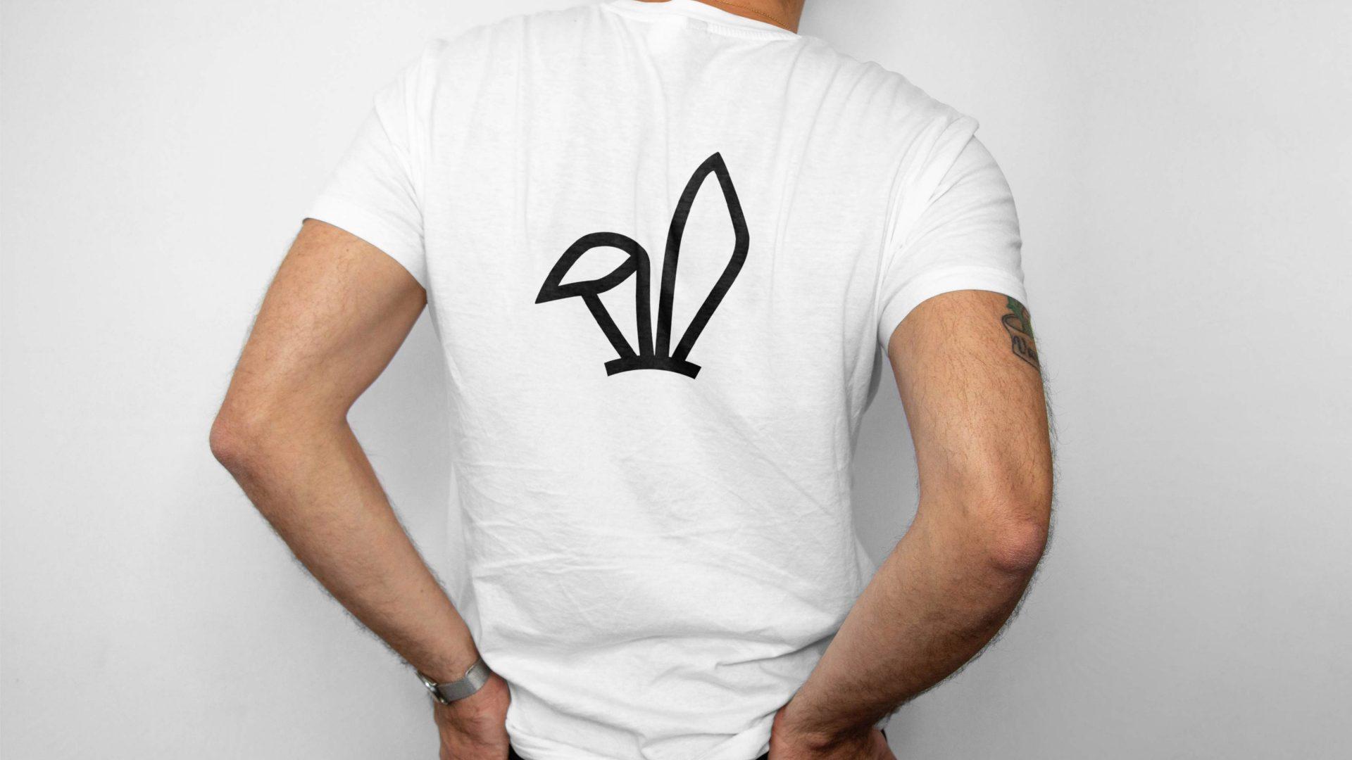 Crate47 Branding forThe Bunny bubble tea shop – black bunny ears design on back of white T-shirt