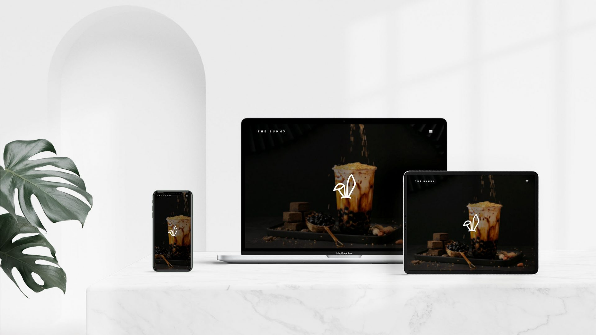 Crate47 Branding forThe Bunny boba tea store – white logo and marque on website on devices